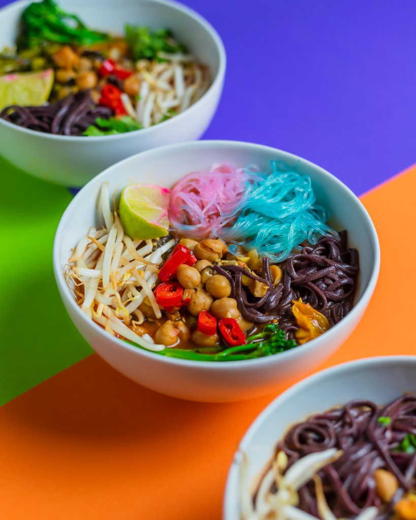 Bowls of soup on colourful backdrop