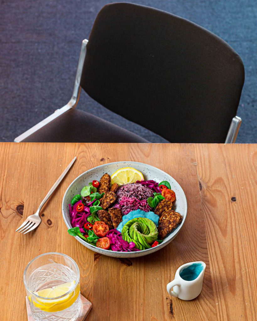 Table set with tempeh salad bowl